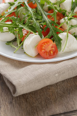 salad from arugula tomatos and baby mozzarella