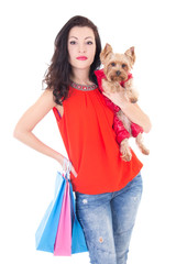 attractive woman holding little dog yorkshire terrier and shoppi