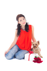 beautiful woman sitting with little dog yorkshire terrier, gift