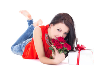 young beautiful woman lying with gift box and flowers isolated o