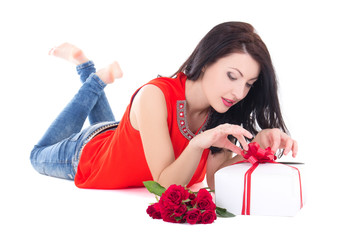 young beautiful woman opening gift box isolated on white