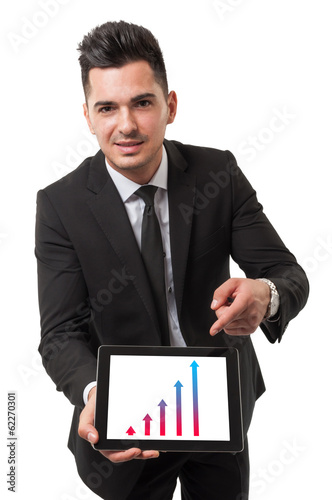 Modern businessman using his digital tablet to show performance