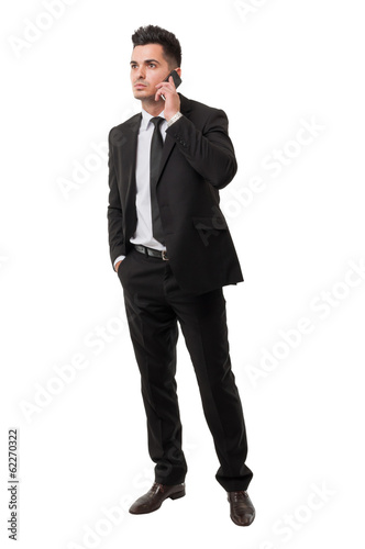 Modern and elegant business man answering his phone