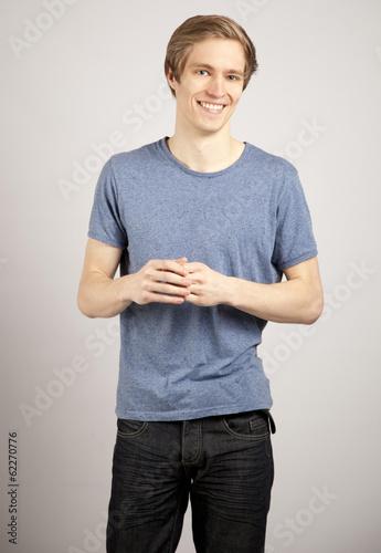 canvas print picture Junger blonder Mann im Gespräch