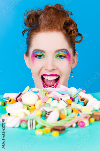 Girl with sweet goodies and candy