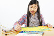 young girl paints with water colors