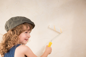 Kid painting wall