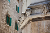 Stone heads at Cathedral of St. James in Sibenik, Croatia