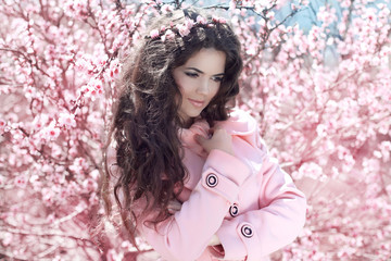 Enjoyment. Portrait of Beautiful woman posing over Pink Spring C