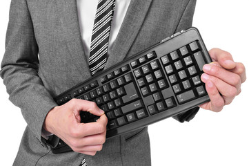 man in suit playing a computer keyboard