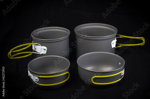 Set of tourist camping tableware with folding handles on black