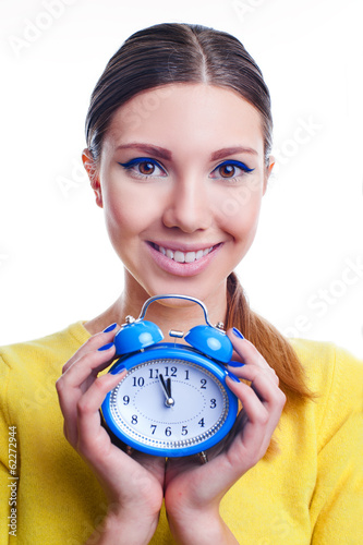 Young beautiful woman holding big and small clocks