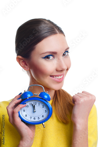 Young beautiful woman holding blue clocks