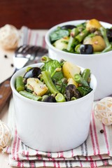 Potato salad with green beans, olives, capers, onions, delicious