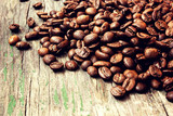 coffee beans on a grunge wooden background