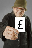 Elderly woman holding card with printed english pound sterling m