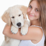 girl holding pet labrador puppy