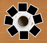 Photo papers and coffee cup on wooden background