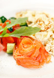 Scrambled eggs with salmon and vegetables