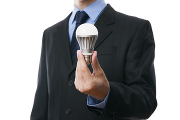 Business man with LED light bulb