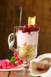 dairy dessert trifle with cherry in a glass