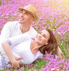 Loving couple on the  floral field