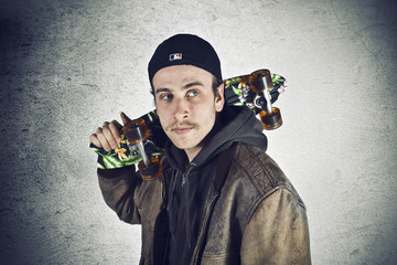 Cool street skateboarder with black cap