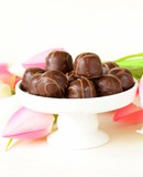 chocolate candy and flowers on white background