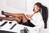 Hot business woman in the office
