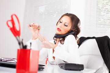 Sexy secretary lacquered nails