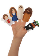 Nativity puppets on a child's hand.