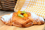 Roll from flaky pastry with fruit