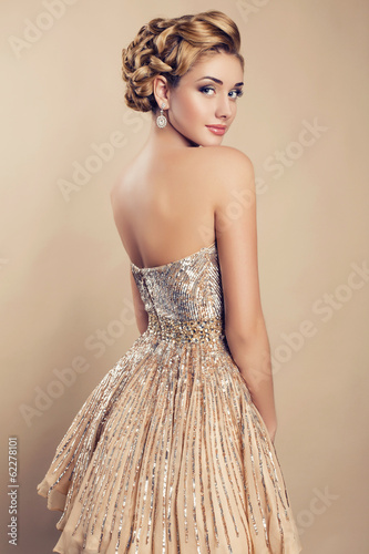 beautiful blond woman in elegant beige dress