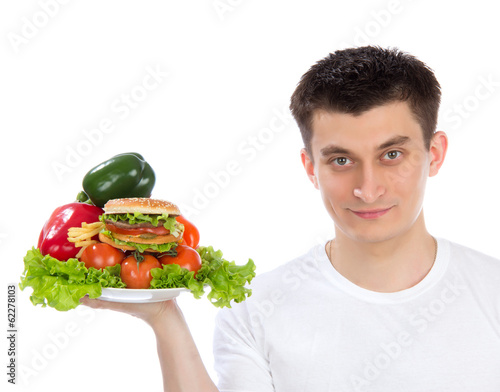 Young man with plate of fresh healthy vegetables salad burger sa