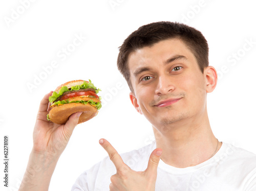 Young man with tasty fast food unhealthy burger sandwich