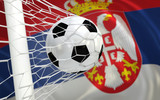 Flag of Serbia and soccer ball in goal net