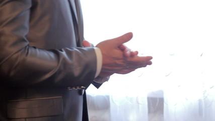 man in a jacket standing near the window
