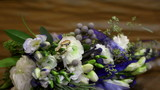 Gold rings lie on a beautiful bride's bouquet