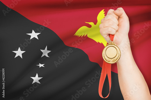 Medal in hand with flag - Independent State of Papua New Guinea