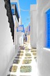 Pretty whitewashed street in the old town of Mykonos, Greece