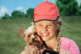 Portrait of a little girl outdoors with dog