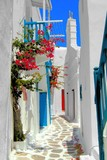 Fototapeta Whitewashed street in the old town of Mykonos, Greece