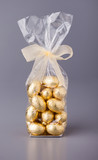 Chocolate mini eggs in a cellophane bag