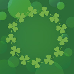 st patricks day background with shamrock wreath on green bokeh
