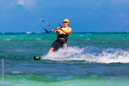 young kitesurfer on sea background Extreme Sport Kitesurfing