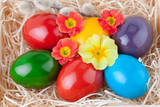 Easter Eggs over Straw decorated with Flowers