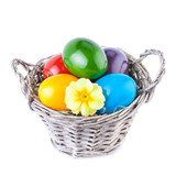 Easter Eggs in a Basket Isolated on White