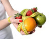 woman hands with fruit  bond with measure tape slave to diet