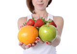 woman carrying fruit in hands healthy lifestyle concept