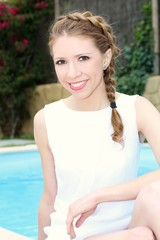 Girl near the swimming pool